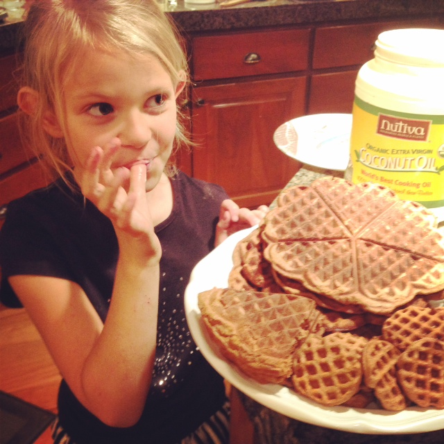 Young girl eating waffles